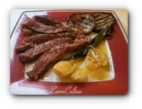 Ribeye Steak mit gegrillten Frühlingszwiebeln